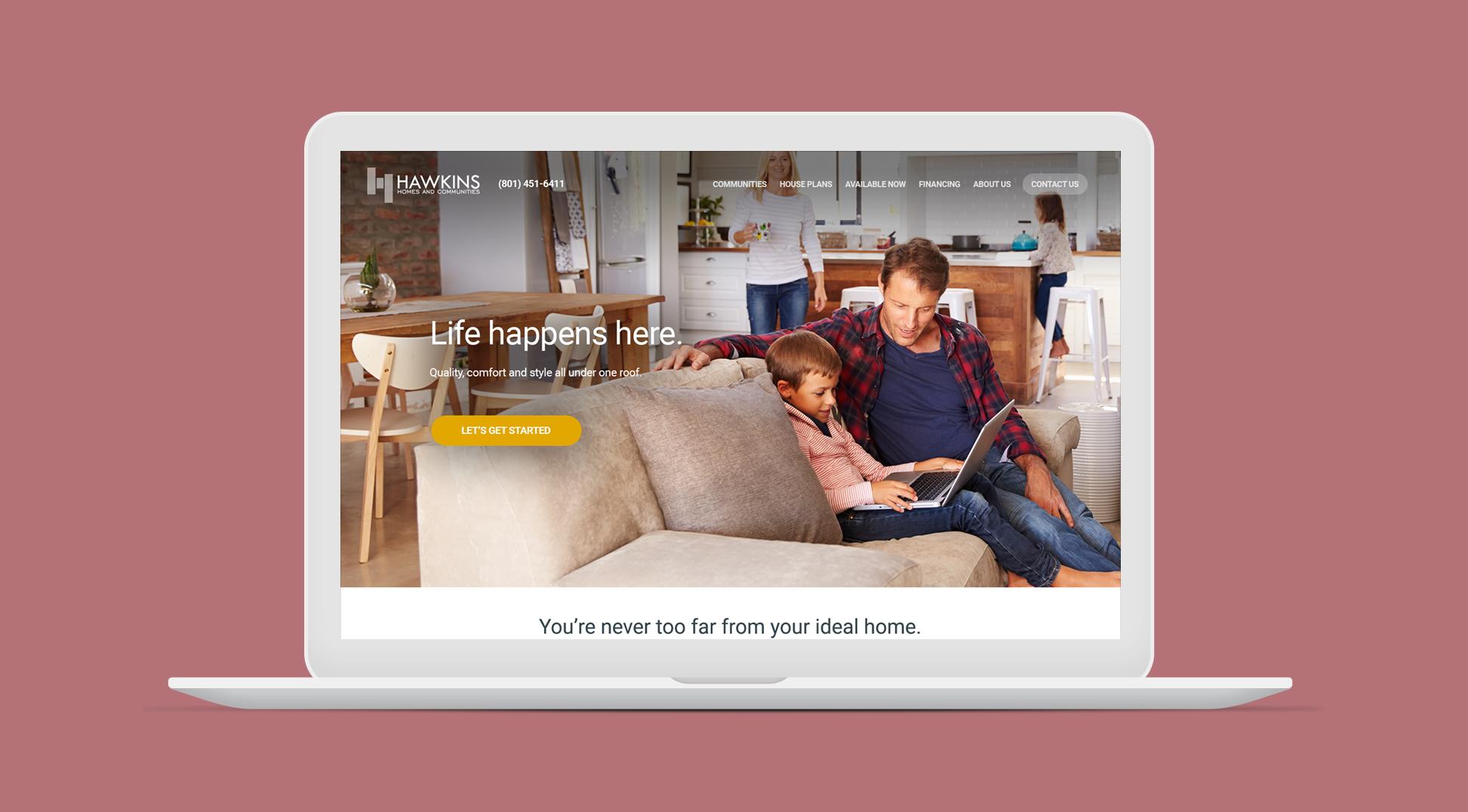 Hawkins Homes website homepage on laptop