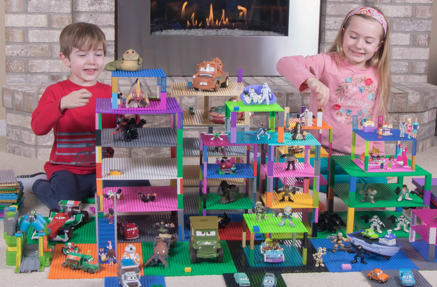 Boy and girl playing with Strictly Briks and other toys