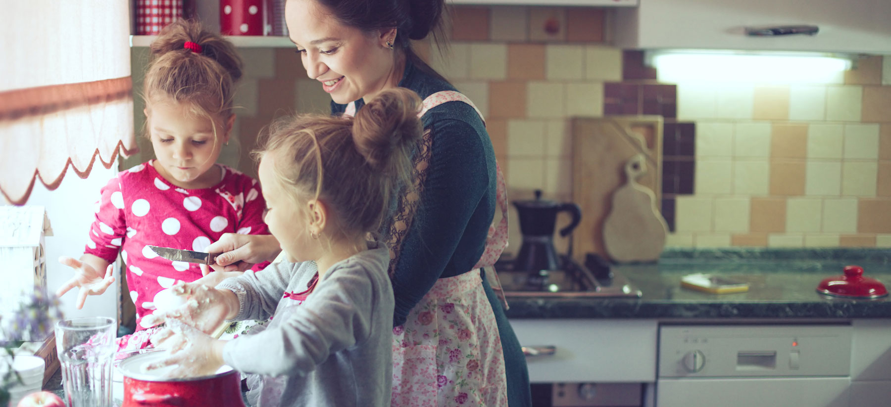 Woman cooking with children
